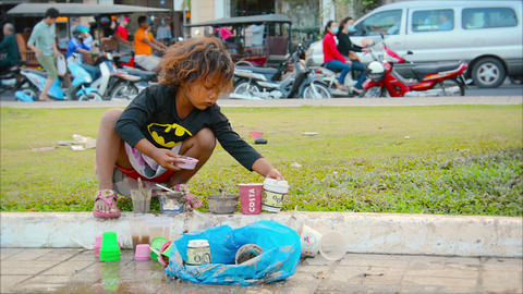 PHNOM PENH. CAMBODIA - 29 DEC 2013: A child plays Footage