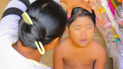 BAGAN. MYANMAR - CIRCA JAN 2014: Mother gets Thana Footage