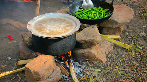 Cooking on a fire in the open air. So feed merchan Footage