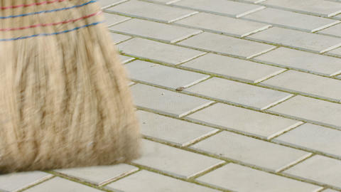 Sweeping the sidewalk. Broom close up Live Action