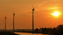 4K turbine towers rotating on sunset Footage