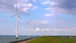 4K Wind power farm with turbine towers rotating Footage