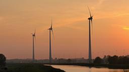 4K turbine towers rotating on sunset Footage