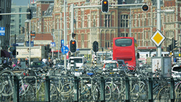 4K Street Traffic By The Amsterdam Central Station stock footage