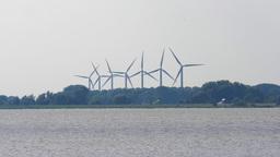 4K scenery, coastline, wind power farm in motion Footage
