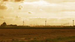 4K agricultural scenery with wind turbine towers Footage
