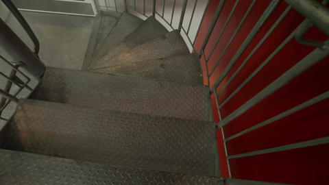 Emergency escape through spiral metal fire staircase 1 Footage