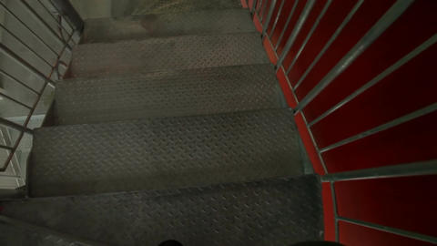 Emergency escape through spiral metal fire staircase 1b Stock Video Footage