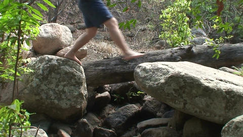 Malawi: boy walking on a rocks Footage