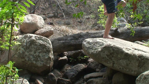 Malawi: boy walking on a rocks Stock Video Footage