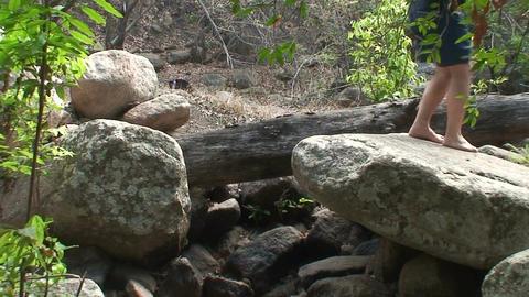 Malawi: boy walking on a rocks Stock Video Footage