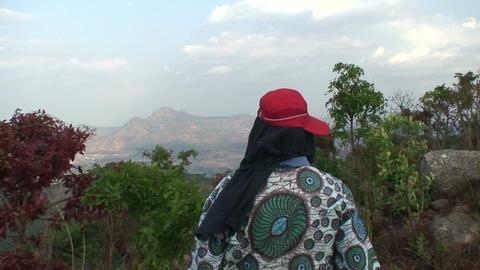 Malawi: man watching mountains Stock Video Footage