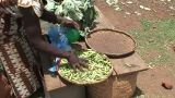 Malawi: African Woman Sells Pease In A Market stock footage