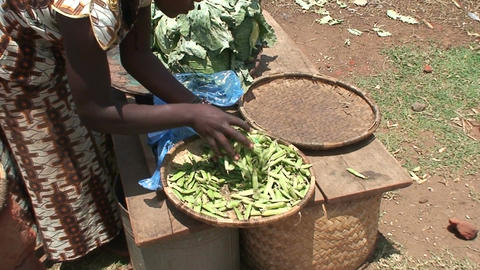 Malawi: african woman sells pease in a market Footage
