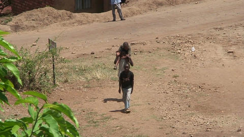 Malawi: african children approaching the wall Footage