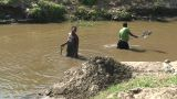 Malawi: African Women Takes Soil From The River Bottom stock footage