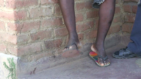Malawi: moving legs of african boy Stock Video Footage