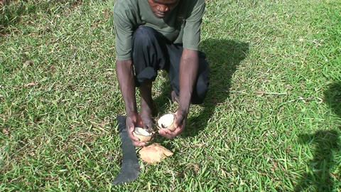 Malawi: african teen cuts coconut 1 Footage