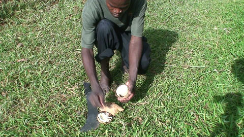 Malawi: african teen cuts coconut 1 Stock Video Footage