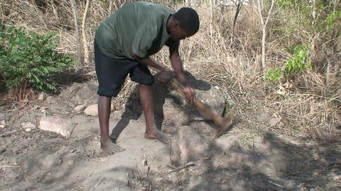 Malawi: african worker removes stones 1 Stock Video Footage