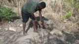 Malawi: African Worker Removes Stones 1 stock footage