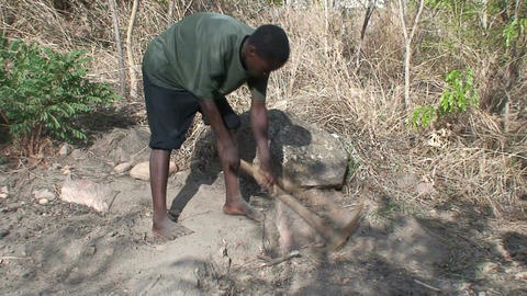 Malawi: african worker removes stones 1 Footage