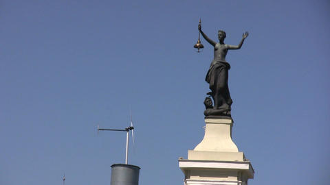 Lady Justice and windmill Live Action