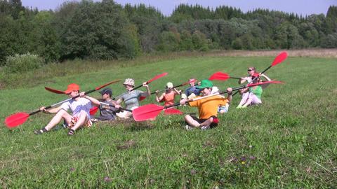 Canoe paddling training on a ground 1B Stock Video Footage