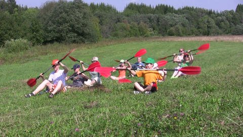 Canoe paddling training on a ground 1B Stock Video Footage