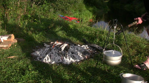 Cooking on open fire 1 Stock Video Footage