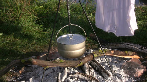 Drying wet clothes on a campfire 1 Stock Video Footage