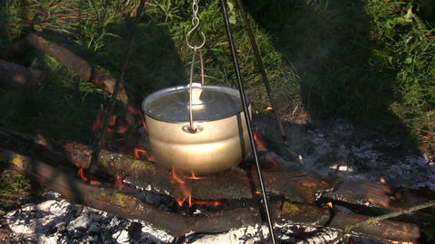 Cooking on open fire 4 Footage