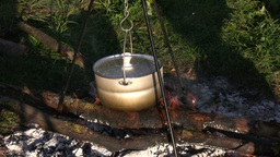 Cooking on open fire 4 Stock Video Footage