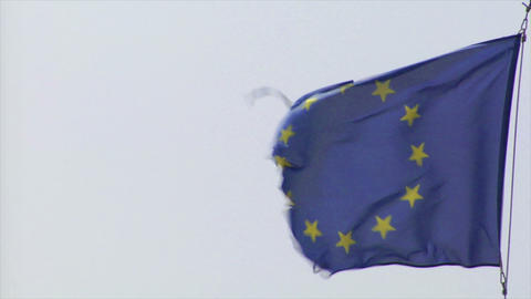 frayed euro flag in heavy wind Stock Video Footage