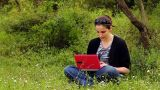 Beautiful Girl Using Computer In Countryside stock footage