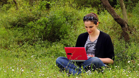 beautiful girl using computer in countryside Stock Video Footage