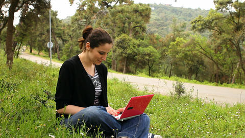 beautiful girl using computer in countryside, bicycles... Stock Video Footage