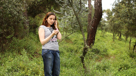 beautiful girl talking on the phone in countryside Stock Video Footage