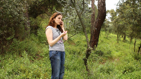 beautiful girl talking on the phone in countryside Footage