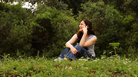 beautiful girl talking on the phone in countryside 2 Stock Video Footage