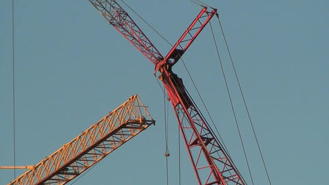 Arrows of two cranes on blue sky background, view Footage