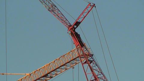 Arrows of two cranes on blue sky background, view Stock Video Footage