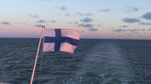 Finnish flag on passenger cruise ship at sunrise, close-up Stock Video Footage
