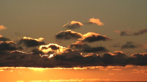 Clouds at sunrise from moving ship Stock Video Footage