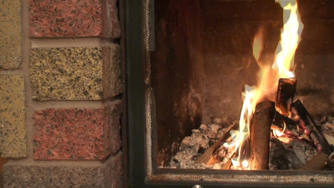 Fireplace burning flames, pan Stock Video Footage