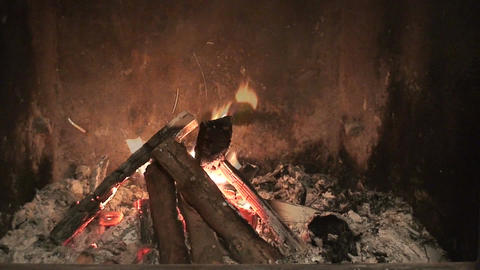 Blowing fire in fireplace Stock Video Footage