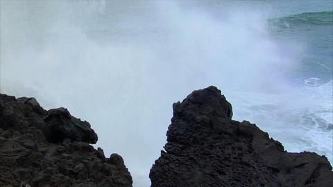 big wave crushing lava coast slow motion Stock Video Footage
