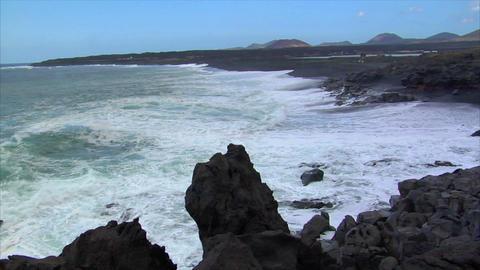 waves on black lava beach Stock Video Footage