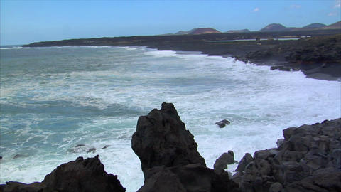 waves on black lava beach Footage