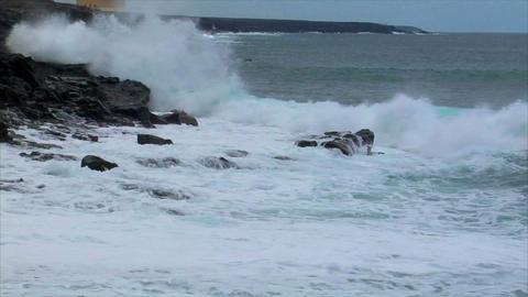 smashing waves black lava slowmo Stock Video Footage